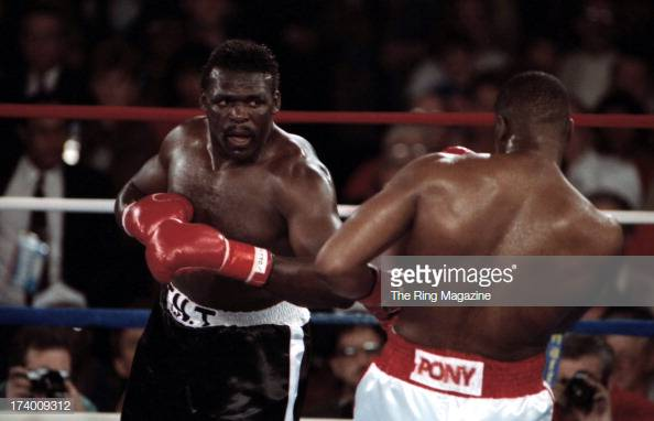 tony-tubbs-looks-to-land-a-punch-against-riddick-bowe-during-the-at-picture-id174009312