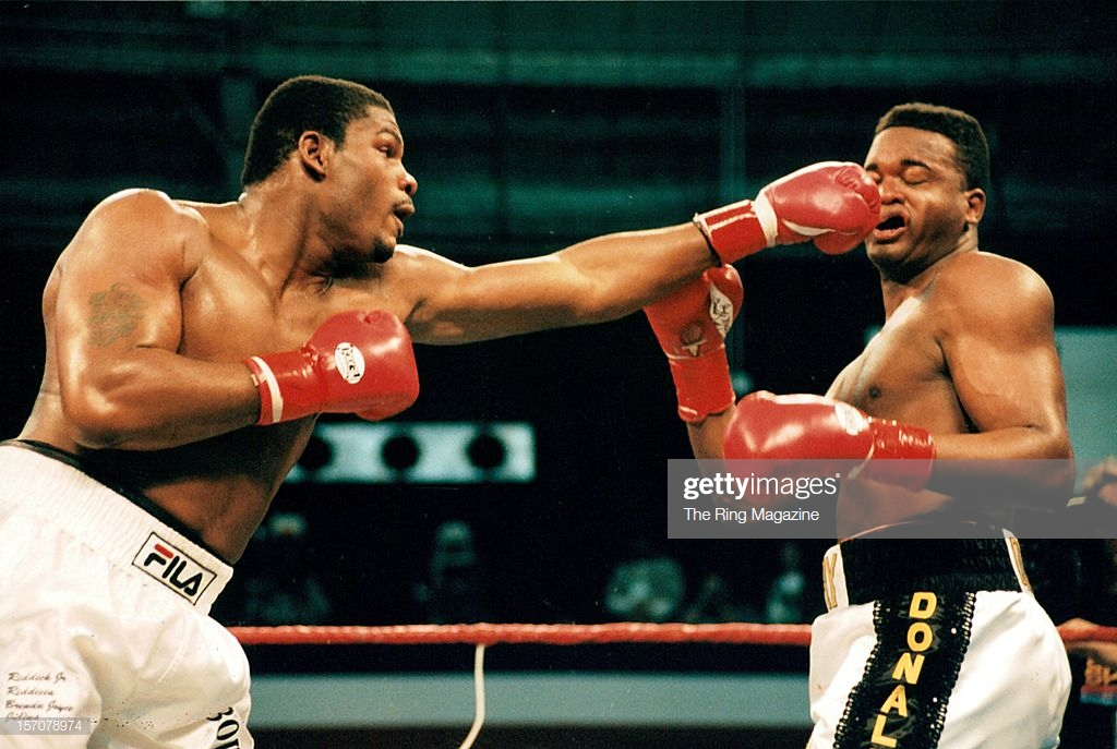 riddick-bowe-connects-with-a-left-jab-to-larry-donald-during-the-at-picture-id157078974