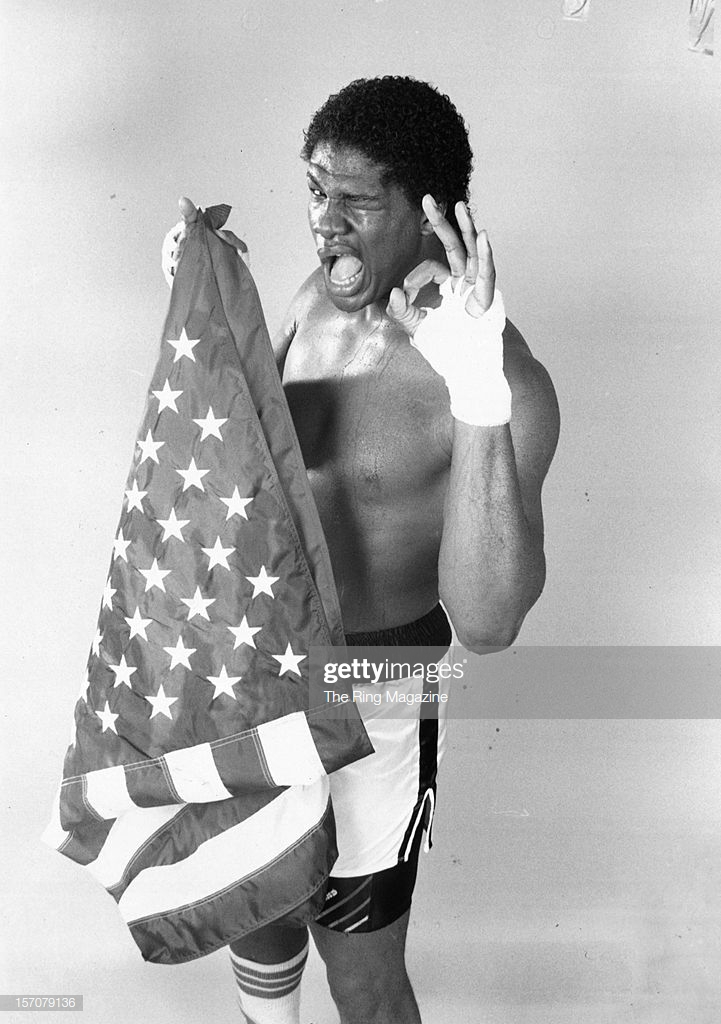 olympian-riddick-bowe-poses-with-the-american-flag-in-july-1988at-picture-id157079136