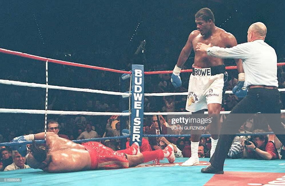 heavyweight-champion-riddick-bowe-stands-over-challenger-jorge-luis-picture-id51688656