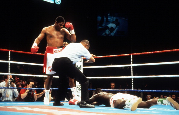 riddick-bowe-looks-on-after-knocking-out-herbie-hide-during-the-fight-picture-id160046744