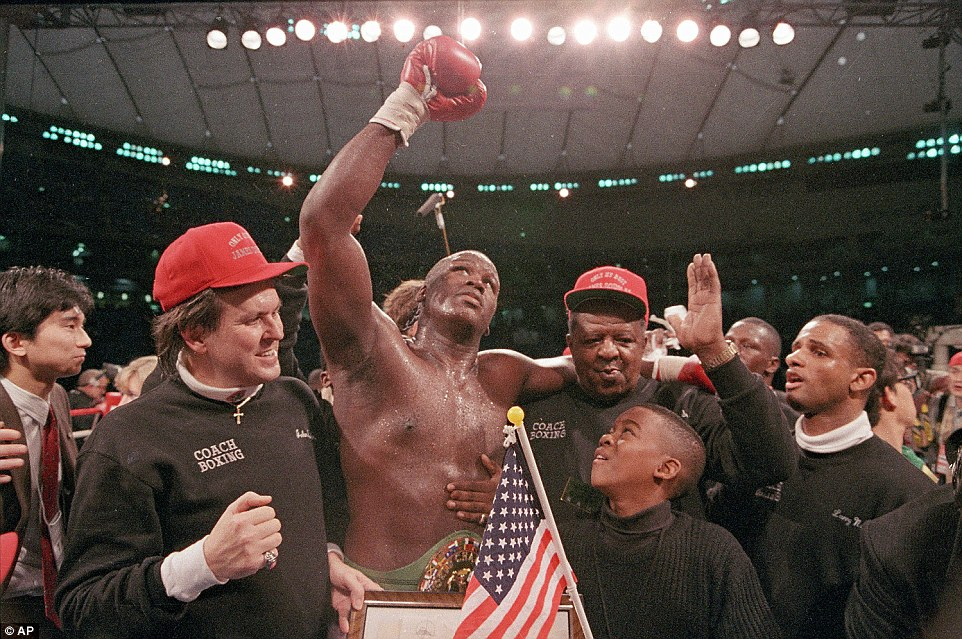 258D300D00000578-2948936-Douglas_celebrates_his_victory_over_Tyson_in_what_was_one_of_the-a-54_1423673326070