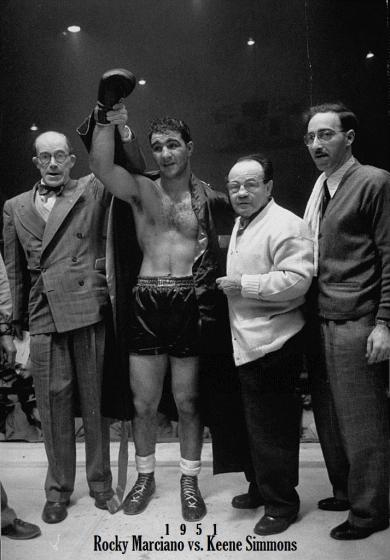 January_1951_winner_Rocky_Marciano_vs_Keene_Simmons_TKO_8_(Charley_Goldman)