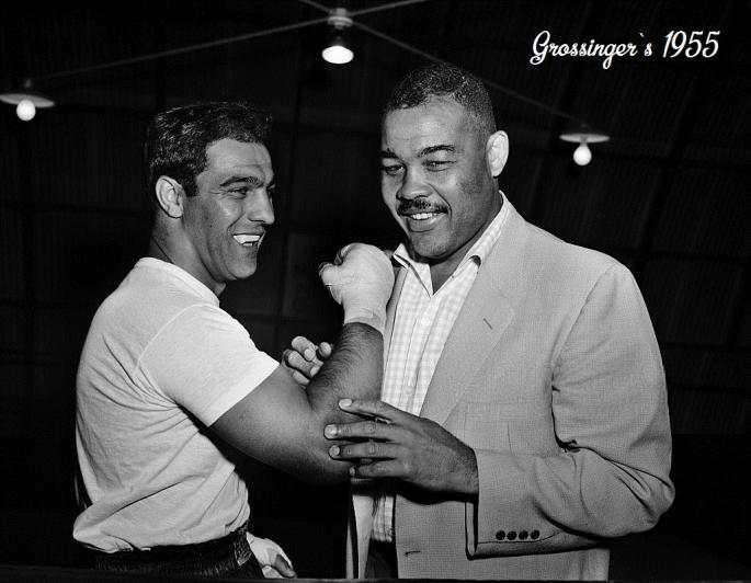 Rocky_Marciano_and_Joe_Louis_talk_boxing_where_Marciano_is_training_for_his_title_defense_against_Archie_Moore_at_Grossingers,_New_York,_September_1,_1955._