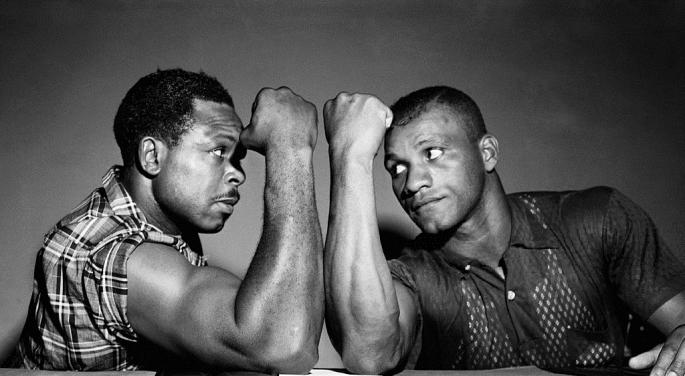 Archie_Moore,_left,_of_San_Diego,_California,_places_his_world_light_heavyweight_title_on_the_line_for_the_third_time_since_he_won_it_in_1952_when_he_faces_Harold_Johnson